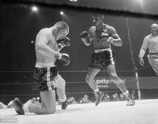 Toronto, Canada- Heavyweight challenger Tom McNeeley sinks to one knee after a two-fisted barrage from world champion Floyd Patterson during their...