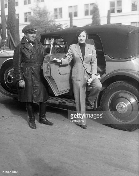 1/25/1933Hollywood CA Miss Marlene Dietrich is shown leaving the Paramount Studio after her day's work She is met by her chauffeur Harry Wright