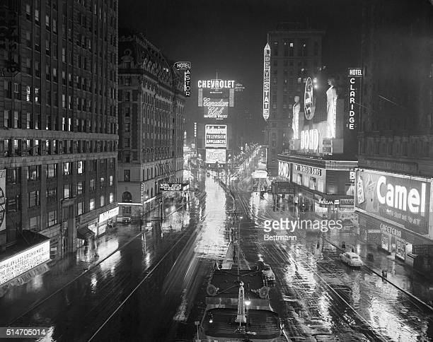 12/5/1952New York NY Times Square on a rainy night takes on an added gleam as the bright lights of Broadway are reflected on the wet pavement