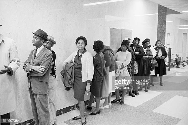 Selma, AL- Negro voter applicants wait in line in a corridor of the Alabama Dallas County Courthouse after having been admitted by an assigned number...