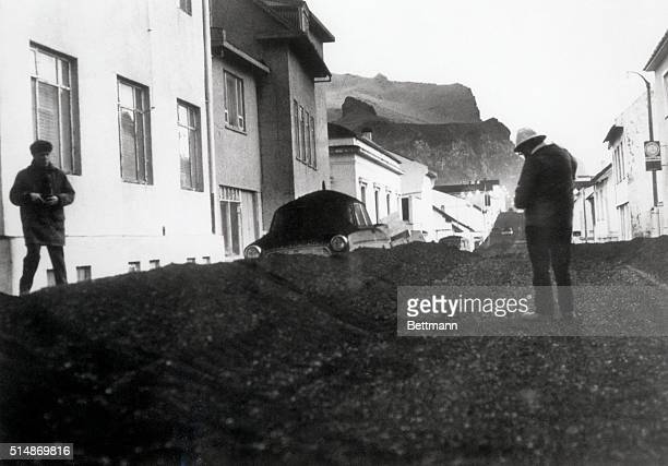 1/25/73Vestmannaeyjar Iceland Volcanic ash covers the main street of Vestmannaeyjar on Iceland's Heimaey Island recently The more than 5000...