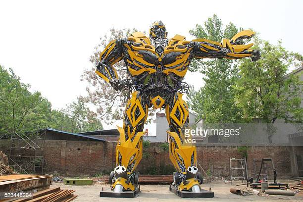 A 125meter tall with the weight of about 17 tons 'Bumblebee' transformer made by a villager Zhang Lei stands on April 22 2016 in Shangqiu Henan...