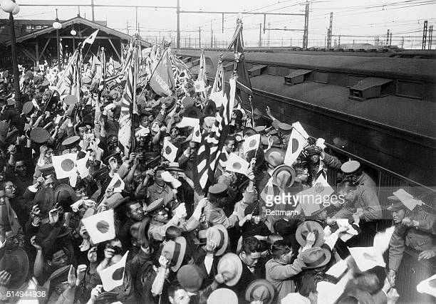 12/6/1931Tokyo Japan A dramatic scene on the railway platform at Tokyo when a train laden with hundreds of Japanese soldiers passed through en route...