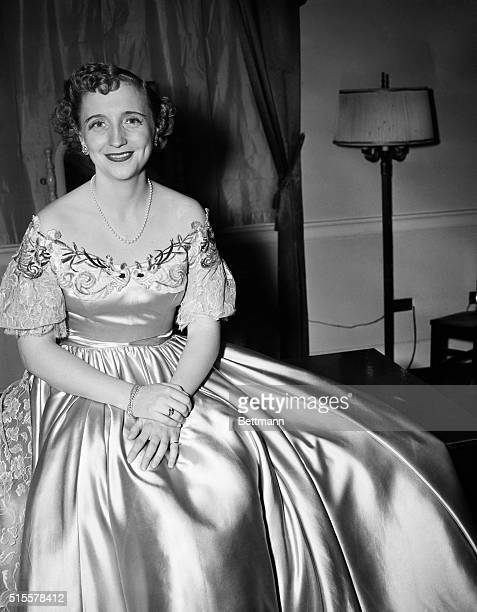Washington, DC: Margaret Truman, daughter of the President, relaxes in her dressing room for newspaper photographer after giving a concert at...