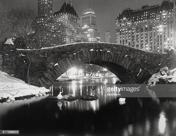 12/6/1957New York New York Majestic apartment houses and hotels along New Yorks City's Fifth Avenue glow like christmas trees while Central Park...