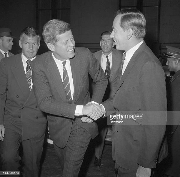 """New York: Gore Vidal, author of """"The Best Man,"""" greets President elect John F. Kennedy as he arrived at the Morosco Theater Dec. 6th to see the play,..."""