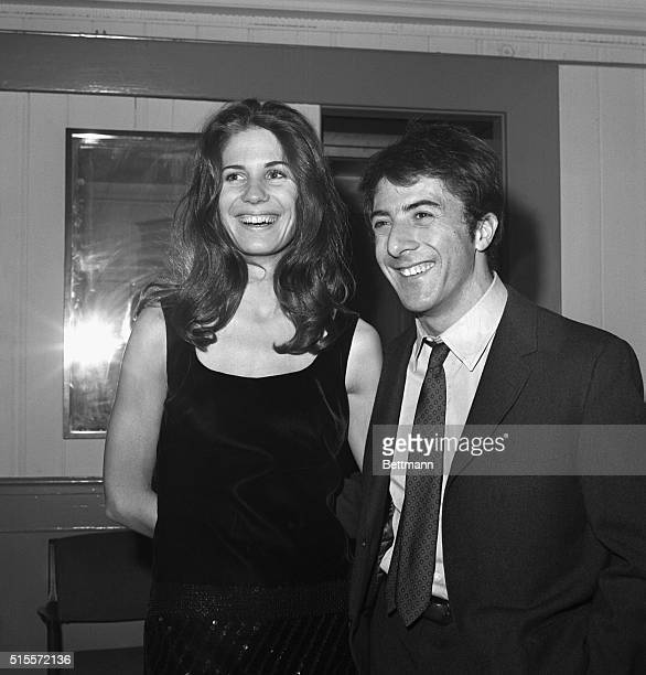New York: Actor Dustin Hoffman and his girl friend, Ann Byrne, smiles for photographers during party at Sardi's here late Dec. 5th following the...