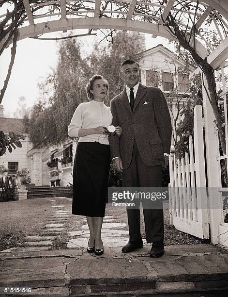 1/27/1956Encino California Clark Gable and his wife Kay are shown at the entrance to their home in Encino about twenty miles from Hollywood