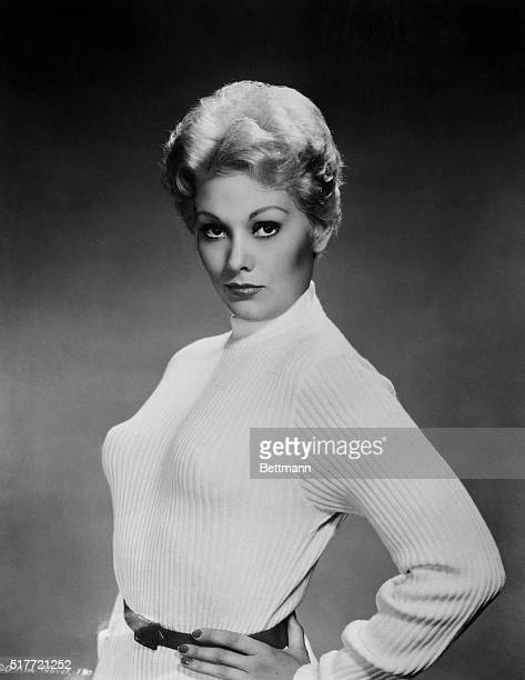 A changed girl is actress Kim Novak who has been here a scant two years but who has reached stardom She has decided against marriage temporarily...