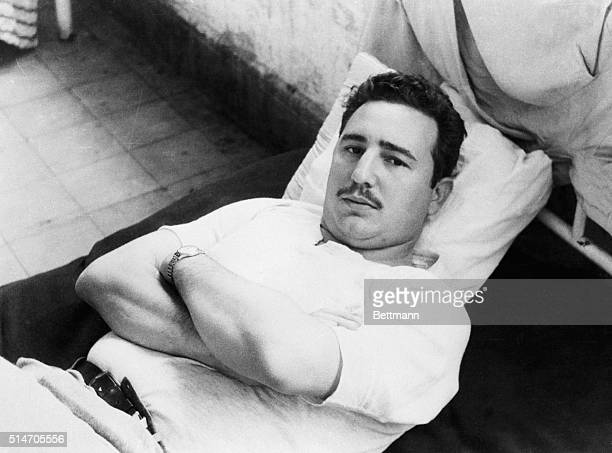 12/7/1956Mexico City Mexico The leader of the Cuban revolution Fidel Castro Ruiz rests on his cot after he was detained by Mexican immigration...
