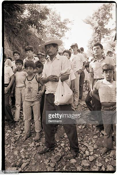 12/7/1982San Sebastian El SalvadorA Salvadoran peasant from the town of San Sebastian waits along with other residents on the outskirts of the town...