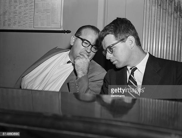 Washington, DC: Chairman Joseph R. McCarthy , of the Senate Investigations Subcommittee, confers with Robert Kennedy, open hearing today since the...