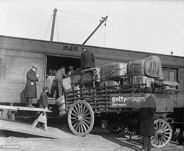12/8/1917New York NY Trucks and vans unloading their supplies at the railroad yards at Hudson River and transferring them into cars of relief train...