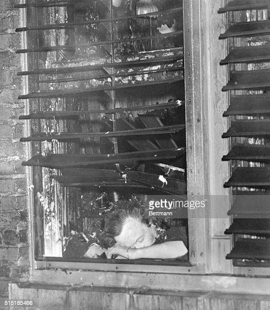 12/8/1946Atlanta GA The dead body of an unidentified woman lies on the window sill of her room in the Winecoff Hotel Atlanta after fire swept the...