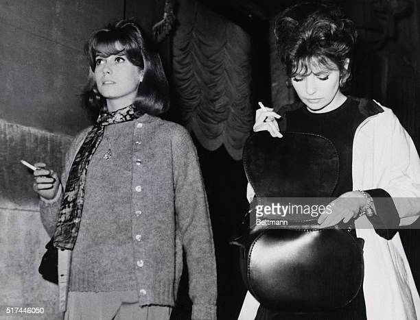 12/8/1961Rome Italy Each holding a cigarette in the right hand two of the three women in French film director Roger Vadim's love life take a stroll...