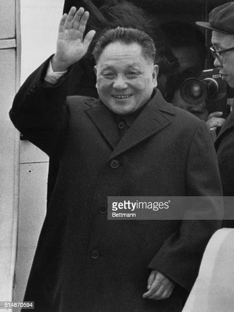 Andrews Air Force Base, Maryland: Chinese Vice Premier Teng Hsiao-ping waves as he leaves his plane on arrival at Andrews Air Force Base. He will be...