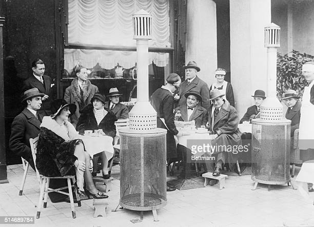 12/8/28Berlin Germany Following a precedent established by cafes in Paris France a cafe in Berlin Germany has installed coke stoves for its patrons...