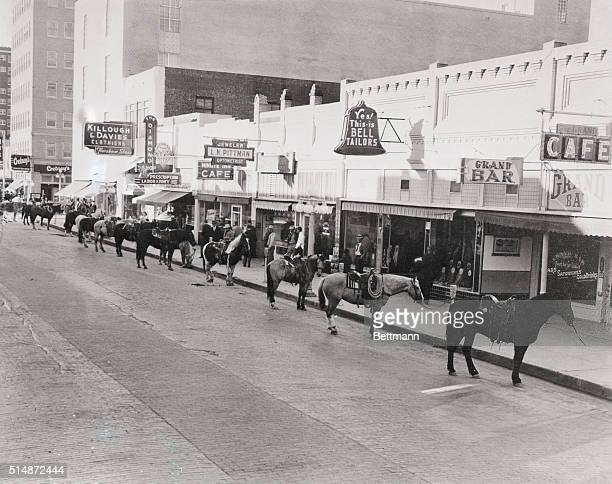 1/28/42Amarillo Texas Forty Amarillo businessmen rode horse to work to save wear and tear on tires Hitch came when horses were left at parking meters...