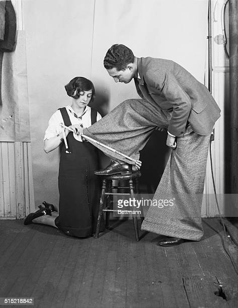 1/29/1926New York NY Miss Tessie Greenfield is shown here proving to the public that the wider the trousers the more collegiate the wearer She could...