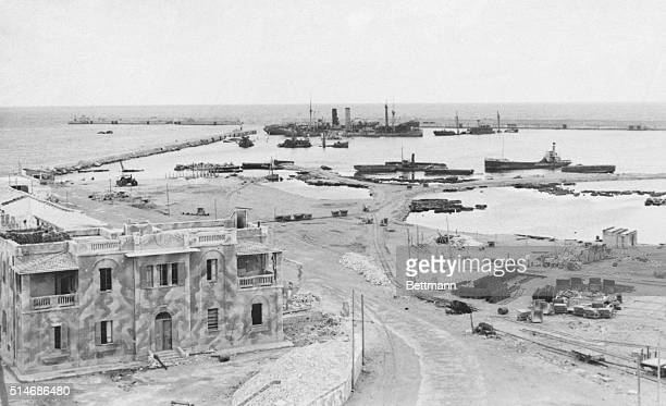 Benghazi Harbor, Libya: General view shows some of the bomb damage to the mole in Benghazi Harbor. Damaged Axis craft lie in the harbor. Today a...