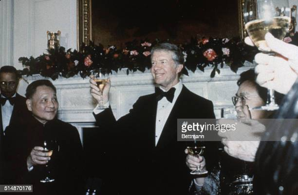Washington, D.C.: President Jimmy Carter, with Chinese Vice Premier Deng Xiaoping and his wife Cho Lin, offering toast at White House state dinner.