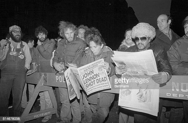 Crowds gathered outside the luxury apartment Dakota 12/9 read newspaper headlines telling of the shooting death of former Beatle John Lennon Lennon...