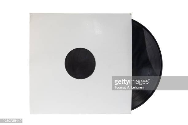 12-inch 33 1/3 rpm LP vinyl record in a old white paper case. Isolated on white background.