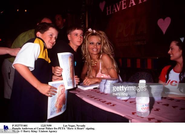 P 352775 001 12Jun99 Las Vegas Nevada Pamela Anderson At Caesar Palace Fro Peta Have A Heart Signing