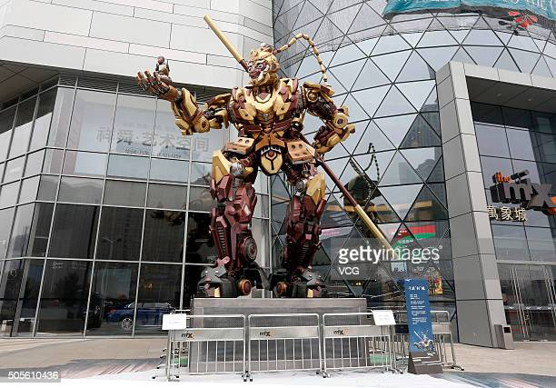 A 12metertall Monkey King transformer model which is holding a small model monkey in its hand stands in front of a shopping mall on January 18 2016...