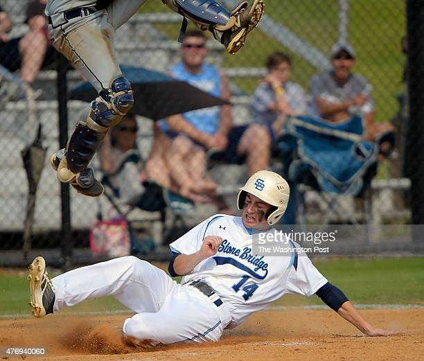 Stone Bridge'sDylan Beck slides under Freeman's leaping catcher for a 6th inning score during Stone Bridge's defeat of Douglas Freeman 6 0 in the...