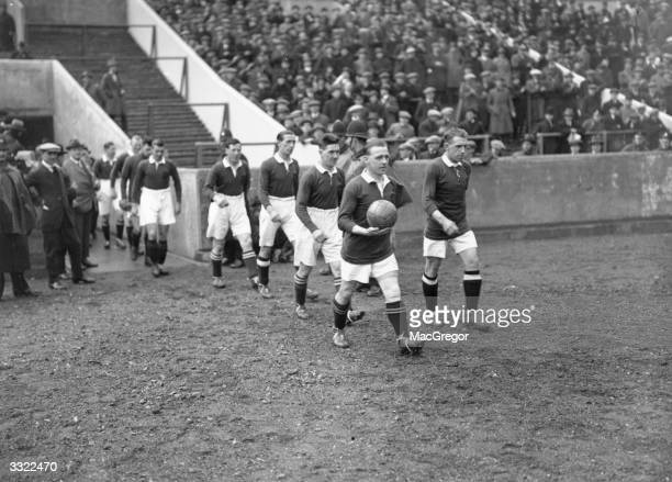 The Scottish national football team taking the field at Wembley for a match against England which was drawn 1 1 The Scots dominated internationals...