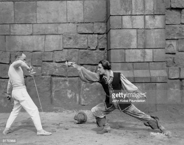 Hollywood star John Gilbert learns the art of fencing for the costume drama 'Bardelys the Magnificent' set in 17th century France