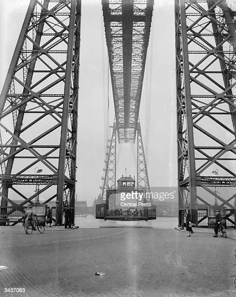 The unique Transporter bridge over the River Tees in Middlesbrough Cars and pedestrians are transported across the river on a hanging section