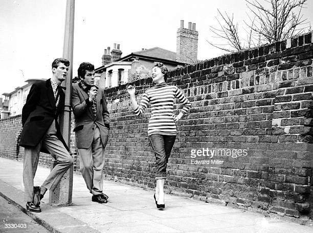 Exboxer Freddie Mills and radio announcer Pete Murray rehearse on a Shepherds Bush street in London for their roles as teddy boys in an edition of...