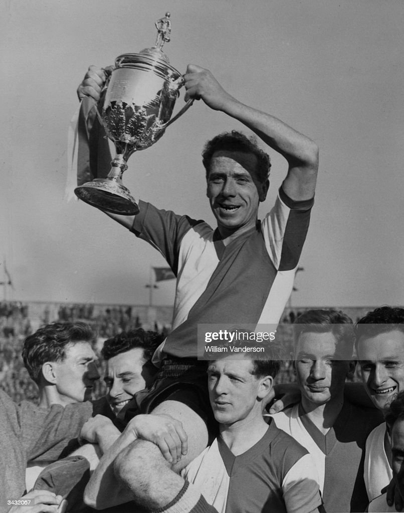 Charles Mortimore, the captain of Woking FC holding the Football Association Amateur Cup after beating Ilford in the final.