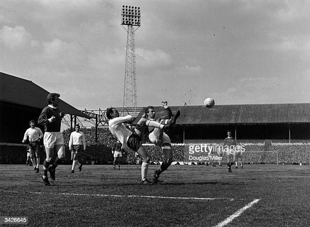 Alan Gilzean of Spurs fights for the ball with Jackie Charlton during a match between Tottenham Hotspur and Leeds at White Hart Lane