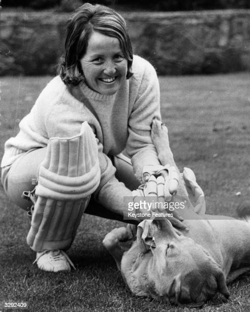The cricketer and sports commentator Rachael HeyhoeFlint at home with her family's pet labrador