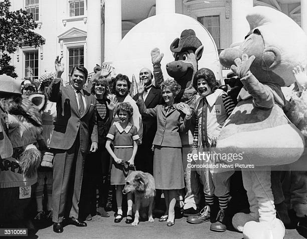 Crowds of people dressed as comic and television personalities join American President Ronald Reagan and wife Nancy on the South Grounds at the White...