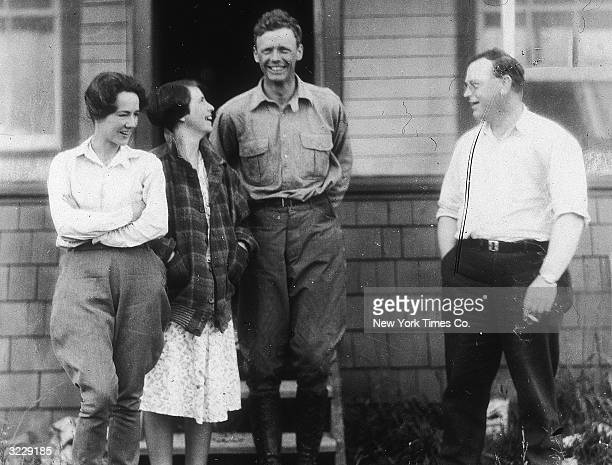 Anne Morrow Lindbergh and her husband American aviator Charles Lindbergh stand with a man and a woman outdoors on the steps of a home After their...