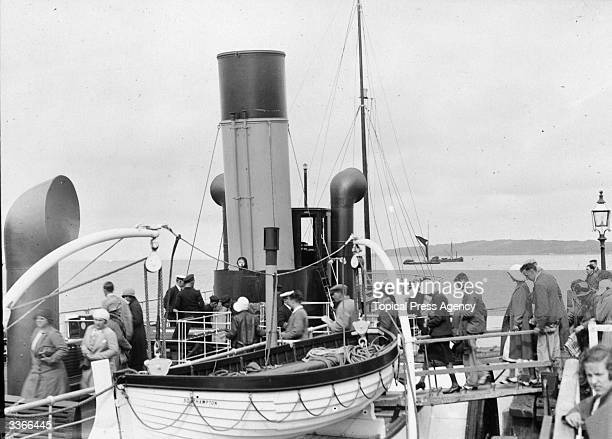 Passengers boarding the ferry steamer at Yarmouth to cross to Lymington, Isle of Wight.