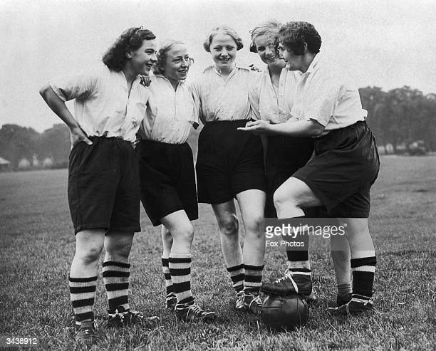 Members of the Preston Ladies Football Club discussing tactics while training for their World Championship match with the Belgian international...