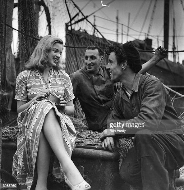 Diana Dors formerly Diana Fluck, the British blonde bombshell chatting with French fishermen on the quayside at Boulogne. Original Publication:...