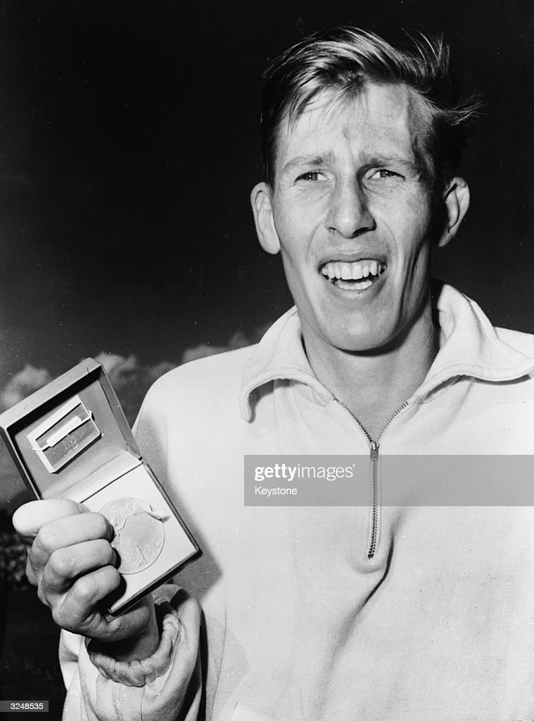 English athlete Roger Bannister with his medal after winning the mile race at the Empire Games in Vancouver.