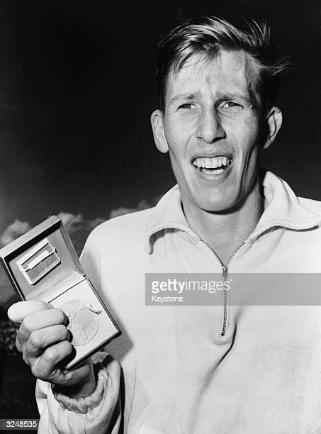 English athlete Roger Bannister with his medal after winning the mile race at the Empire Games in Vancouver