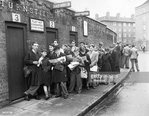 Schoolboys queuing up outside the Oval cricket ground in the hope of seeing the Test Match with Pakistan.