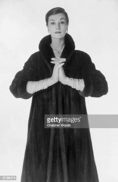 A woman modelling a dark fur coat from Harrods