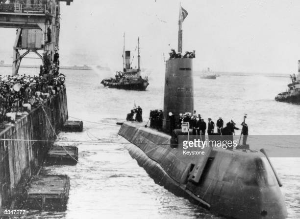 The American nuclear powered submarine Nautilus, with the crew on deck, arriving at Portland harbour having travelled under the North Pole.