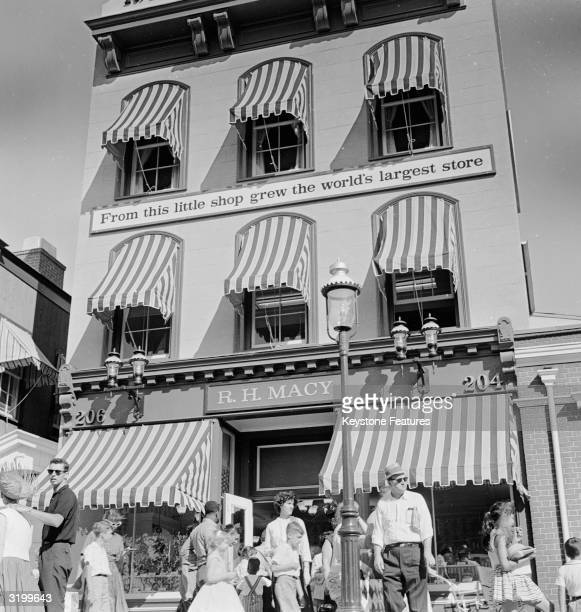 Striped awnings cover the windows of R H Macy a historical shop in Freedomland Park a Wild West themed park in the Bronx New York City A sign on the...