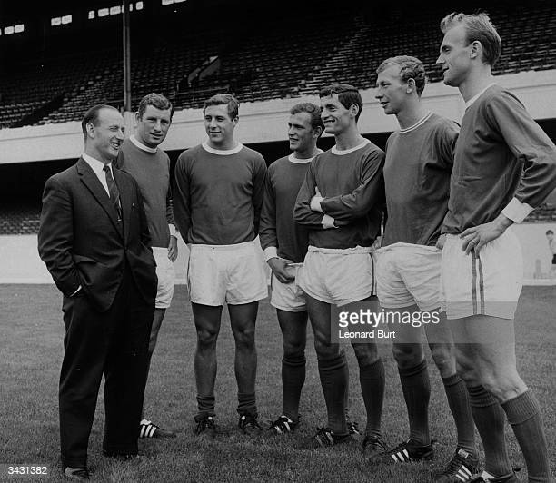 Arsenal manager Bertie Mee talking with members of his team Terry Neil John Radford Tommy Baldwin Frank McLintock Bob Wilson and Don Howe