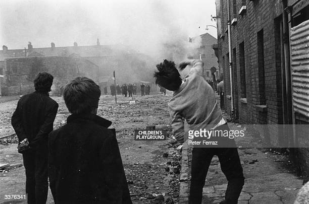Derry youths hurl stones at the RUC in the face of CS gas during the Battle of the Bogside